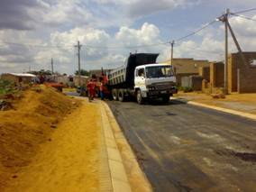 Typical view of road after receiving primer, ready for surfacing in Mohlakeng Township, West Rand